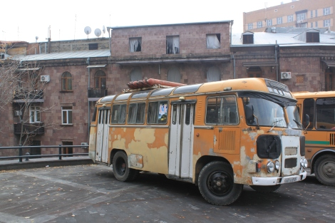 An old bus fueled by propane tanks strapped to the roof